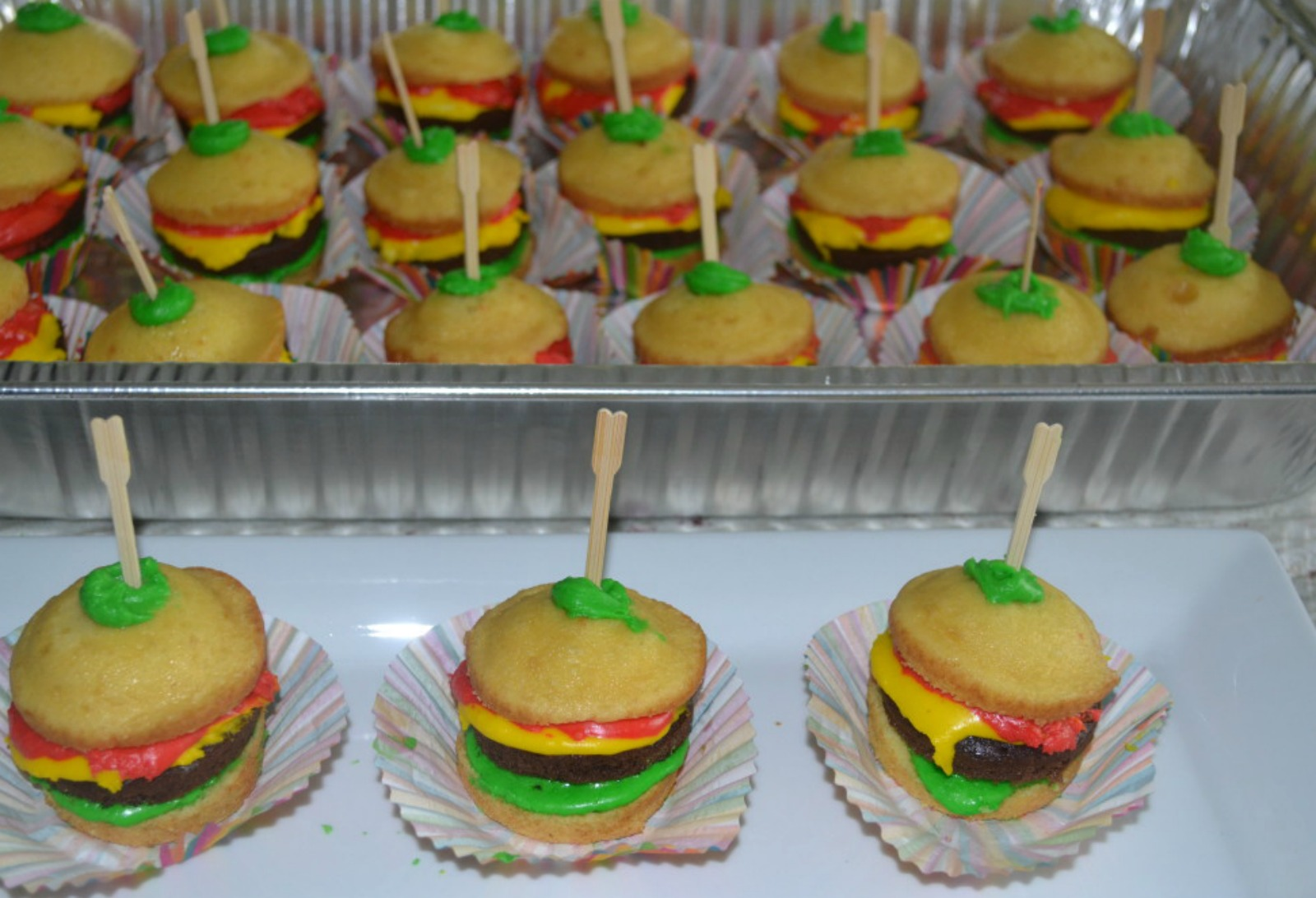 Cook-out Cupcakes are a fun and tasty summertime dessert. Cupcakes are decorated to look like a cheeseburger. Loved by adults as well as children