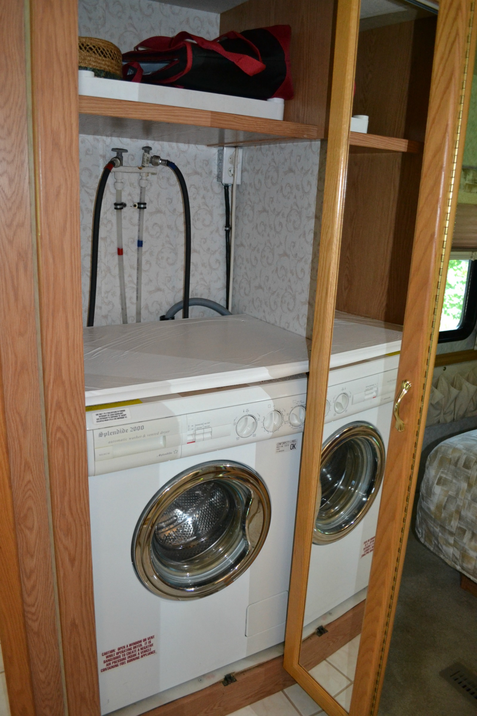 rv travel, camping, inside rv, washer and dryer in rv