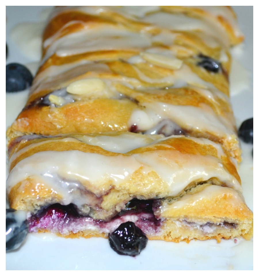This easy breakfast braid is filled with cream cheese and blueberries then wrapped in a crescent crust. It is baked and topped with a warm, sweet glaze.