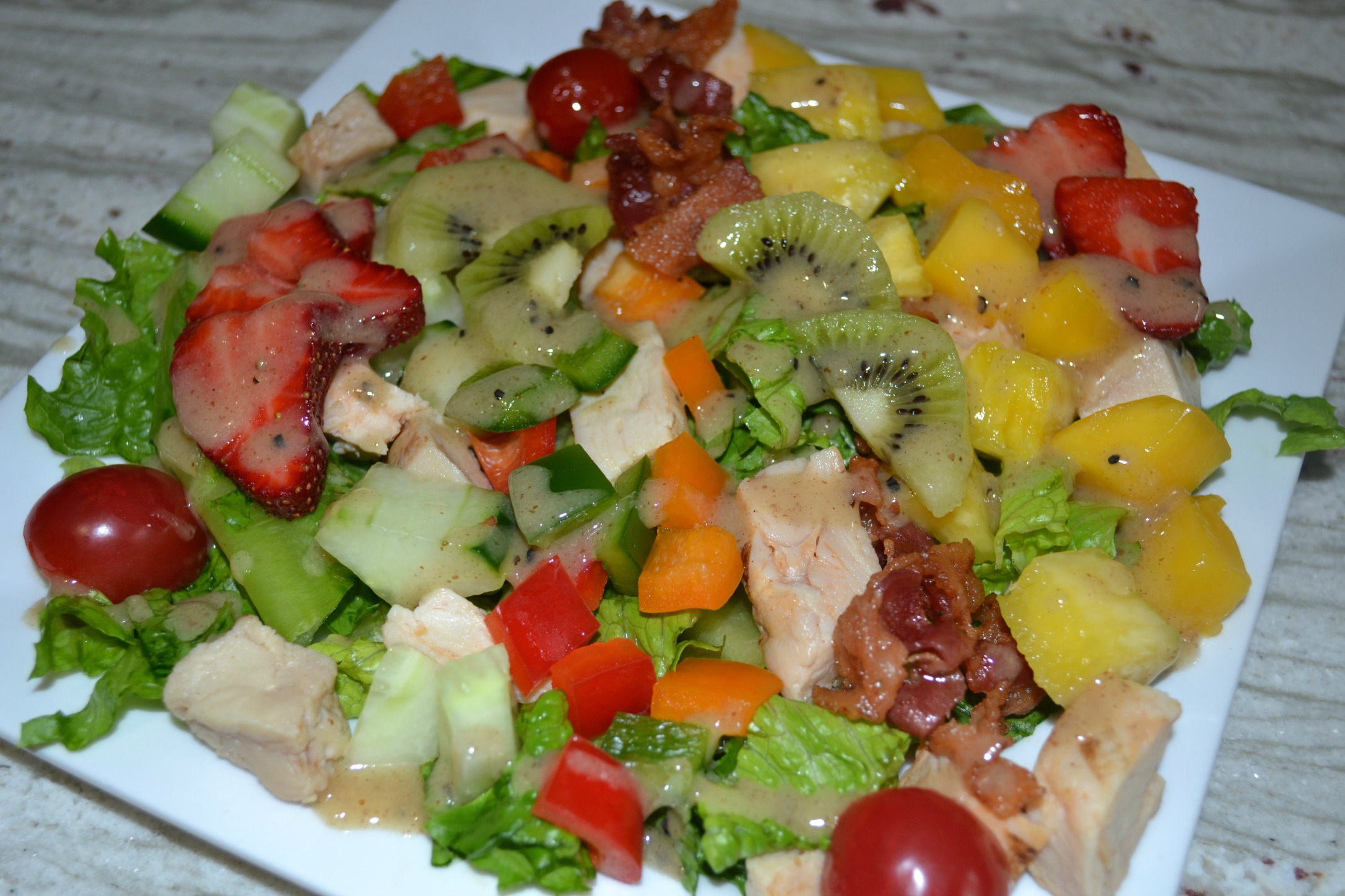 caribbean chicken cobb salad, chicken, mango, pineapple, bacon, kiwi