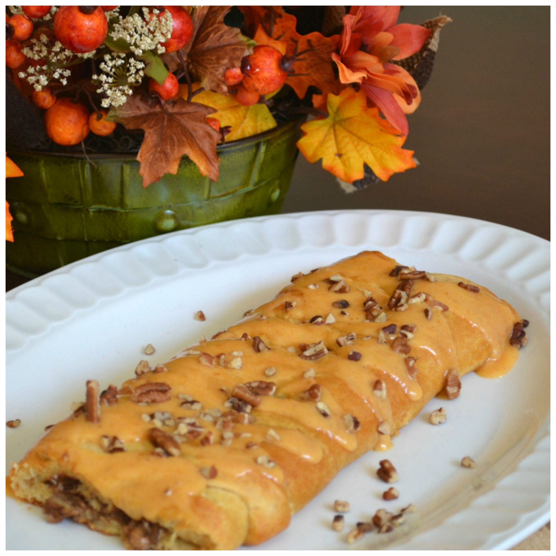 A beautiful breakfast braid filled with pumpkin, nuts, and mascarpone cheese. Baked in a refigerated crescent dough.