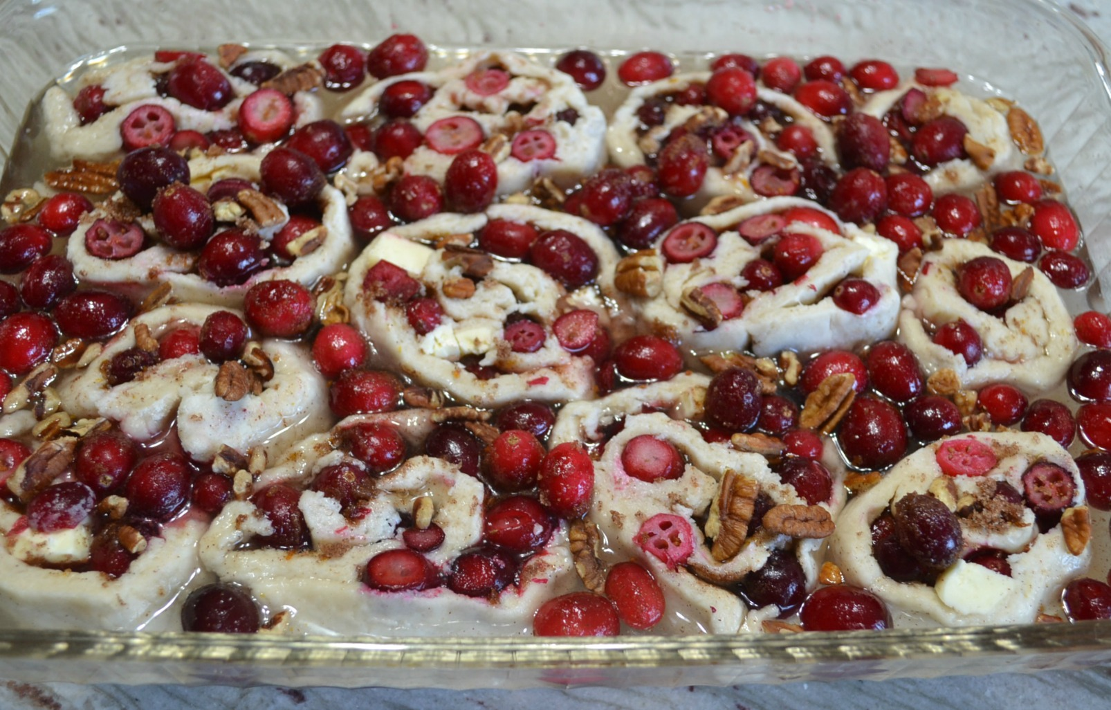 A rustic cranberry-orange-pecan cobbler roll that is perfect to serve as a Thanksgiving dessert.