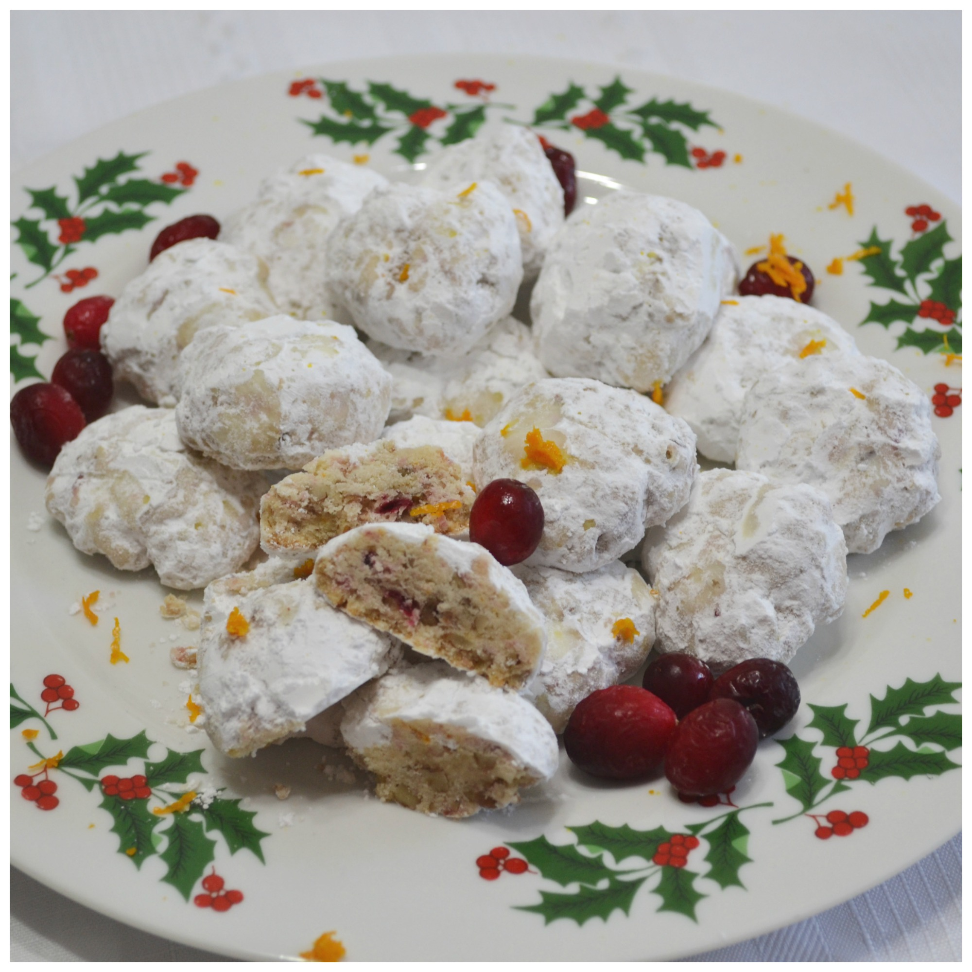 A delicious holiday cookie starting with a snowball recipe and upgraded with frozen cranberries and orange zest.