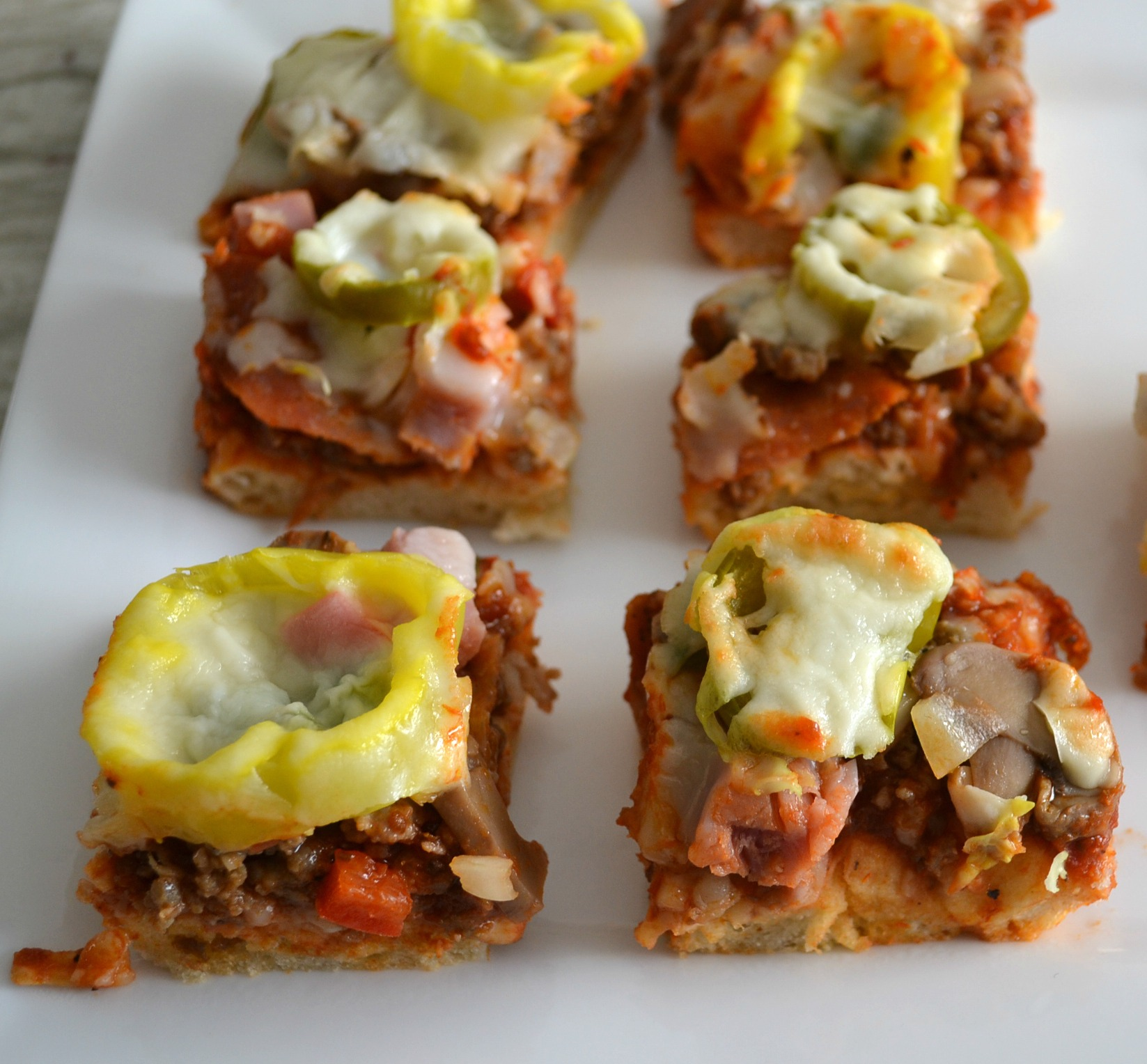 A fun and easy appetizer made from a crust mix, packed with toppings, and cut into bite size servings.