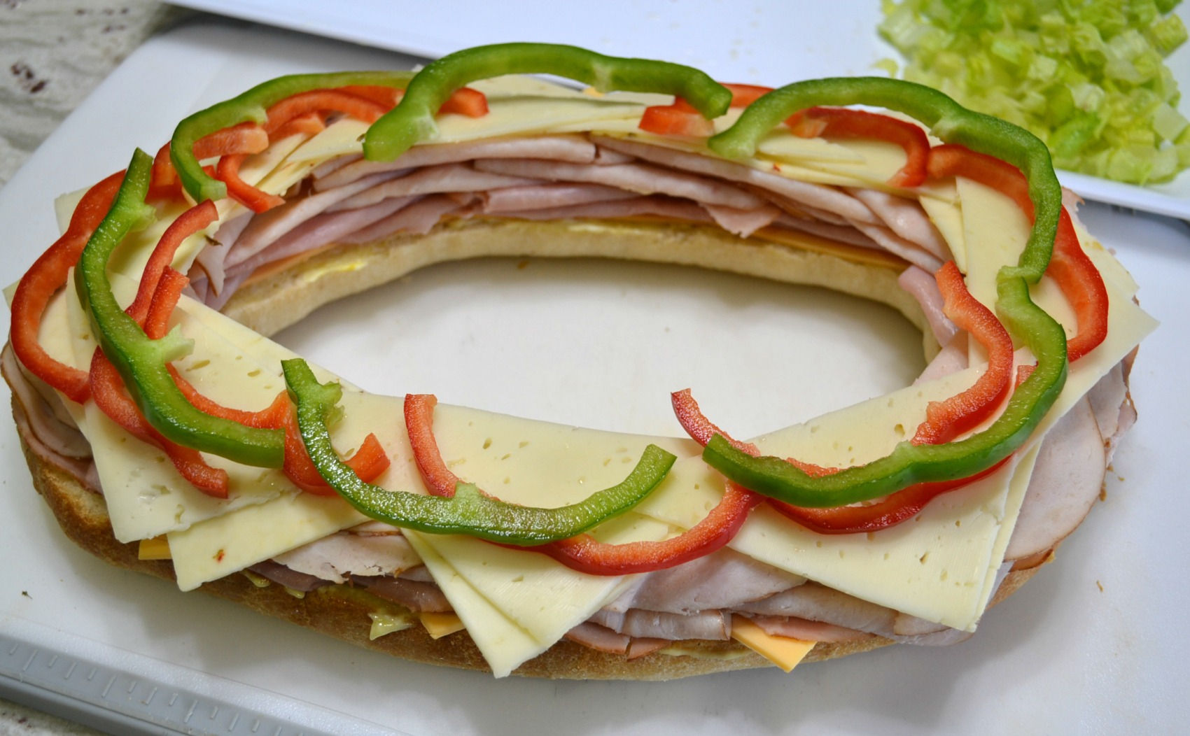 This Sensational Stadium Sandwich is packed with meat, cheese, and veggies. Perfect to serve at any tailgate party