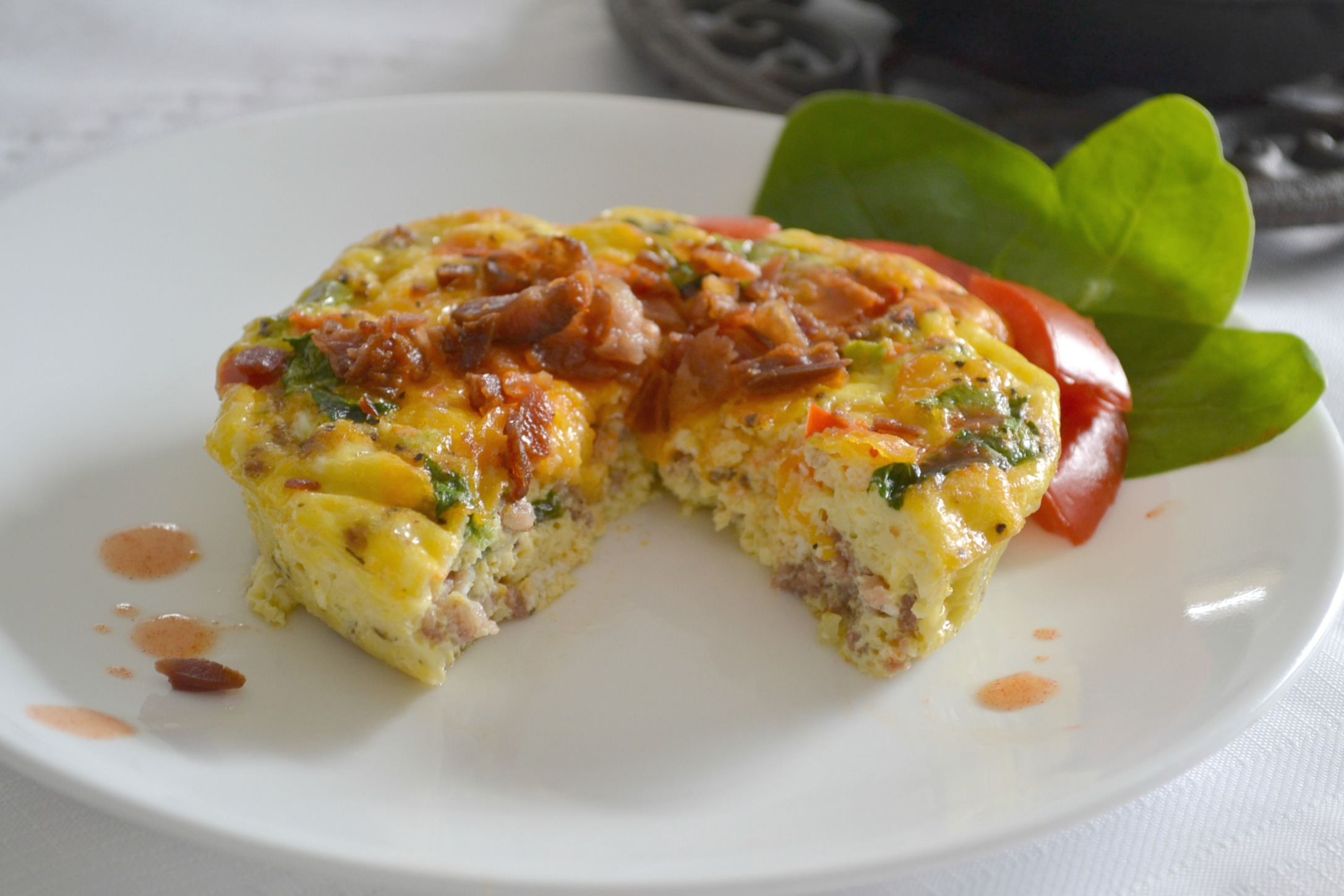 Mini Frittatas loaded with bacon ham, sausage, eggs, cheese, and veggies baked in a mini cast iron skillet.