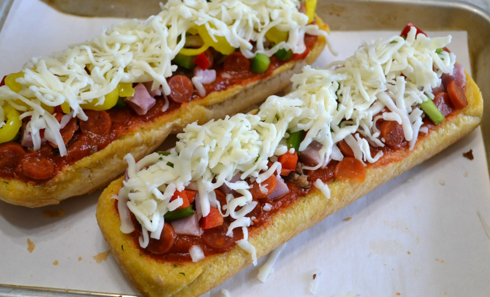 A quick and easy pizza made on a loaf of garlic bread. Add your favorite toppings and cheese for a great snack or lunch.