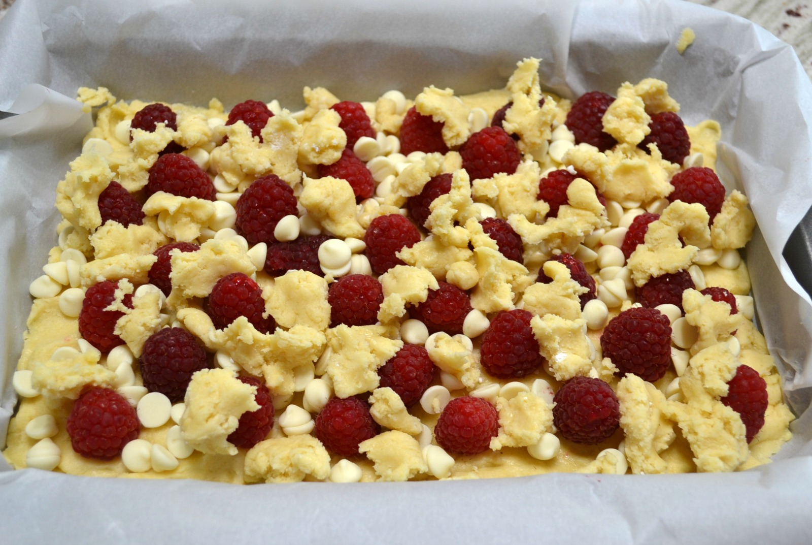 Raspberry White Chocolate Cake Bars are an easy to make, decadent dessert.