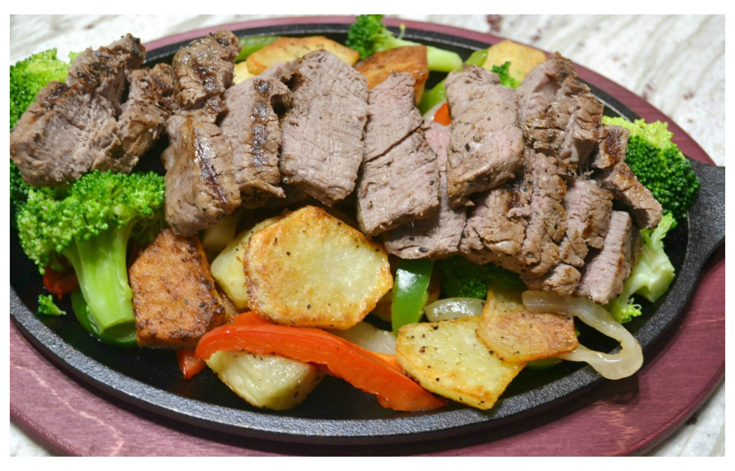 Sizzlin Steak and garlic roasted potato skillets are a delicious twist on a steak and potato dinner
