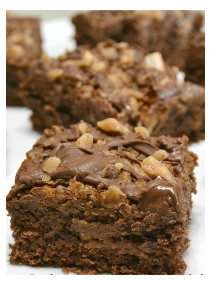 A decadent brownie filled with chocolate sweetened condensed milk, peanut butter and topped with chocolate hazelnut spread.
