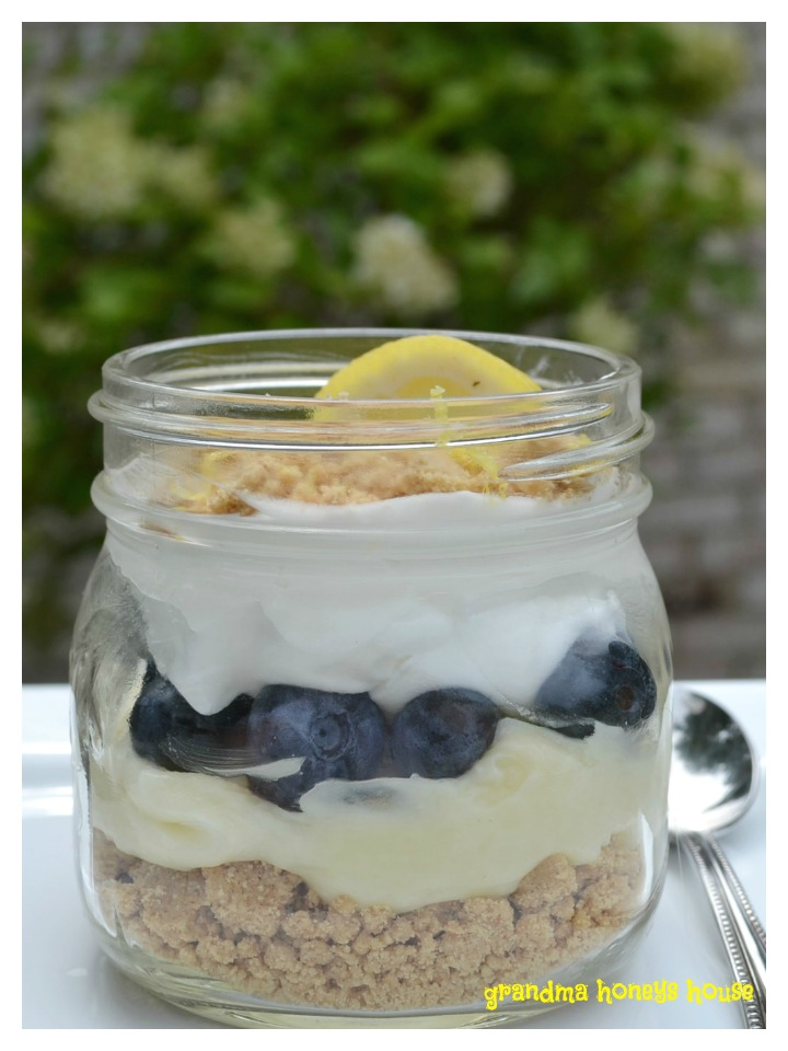 Meyer lemon whipped pudding, blueberries, and mascarpone cheese in a jar is the perfect summertime dessert.