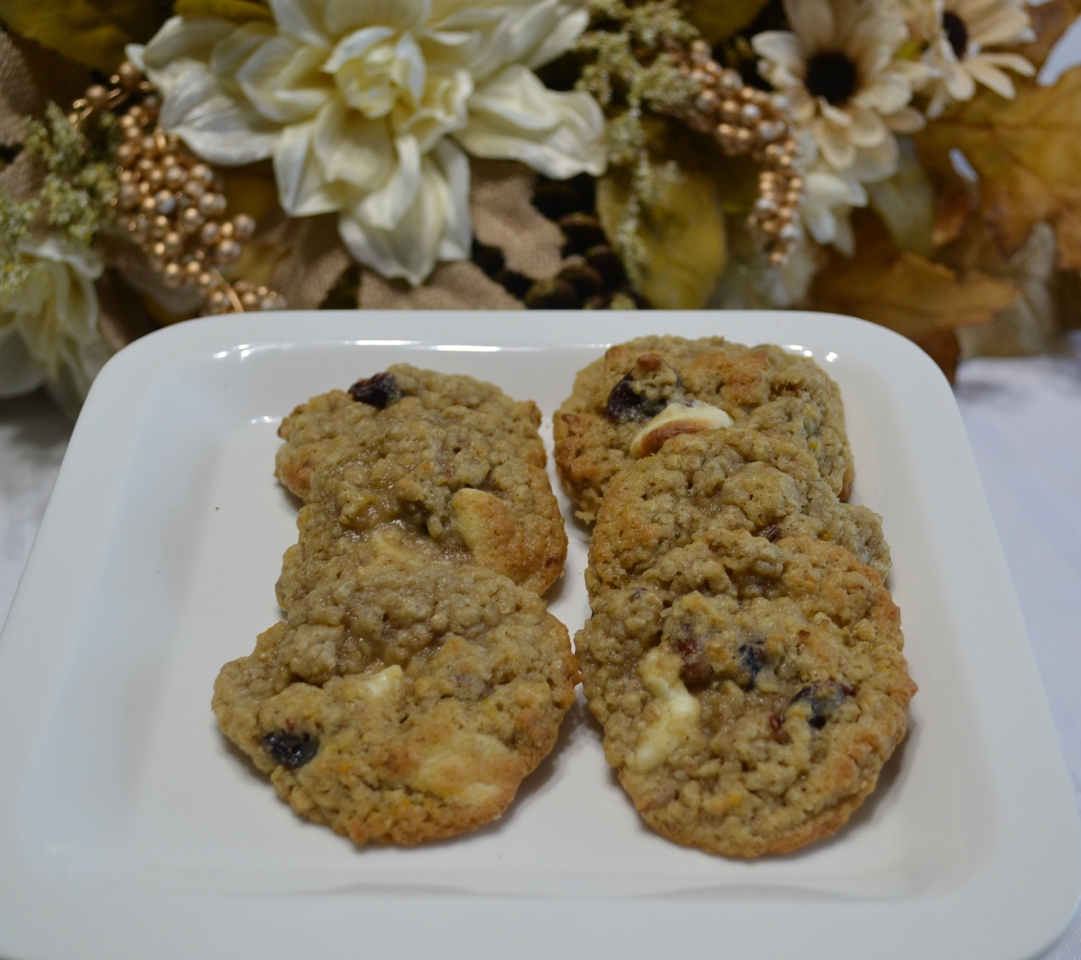 A flavorful oatmeal cookie packed with flavors from cranberry, pecans, and orange zest topped with a melted white chocolate drizzle
