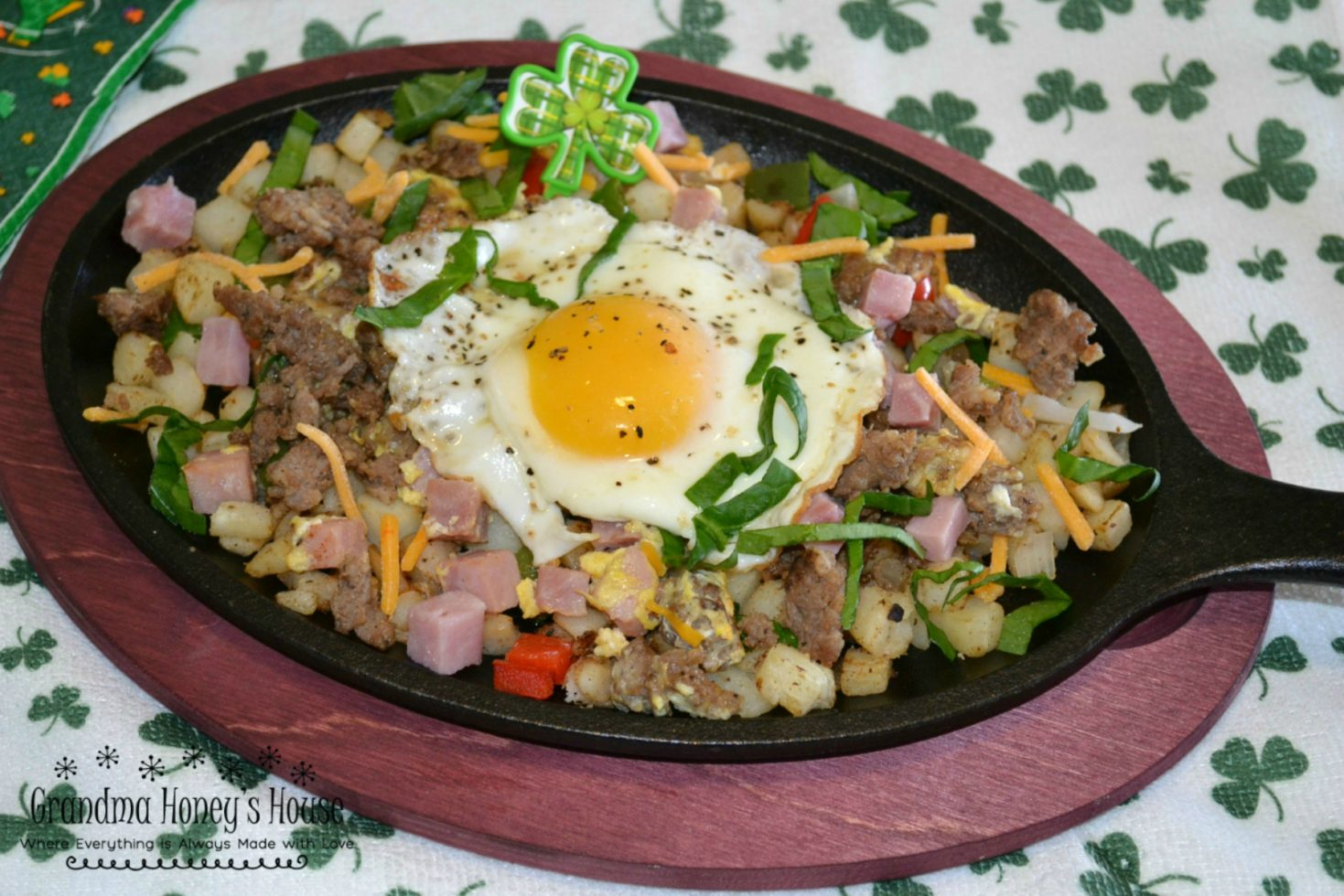 St. Patrick's Day Sizzlin breakfast skillets are packed with eggs, meats, veggies, and cheese.