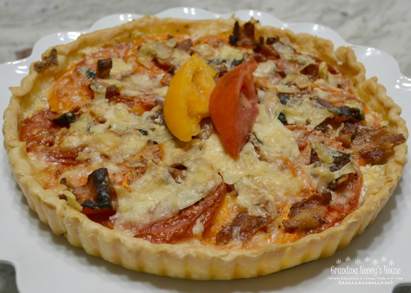 This Garden Fresh Tomato Bacon Tart is a crust filled with chive & onion cream cheese,fontina,fresh tomatoes,bacon and seasonings. Perfect for summertime eating.