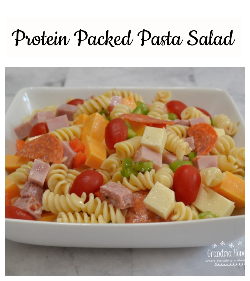 This Protein Packed Pasta Salad is loaded with veggies, meats, and cheeses. Colorful, delicious, and perfect to transport to any summer event.