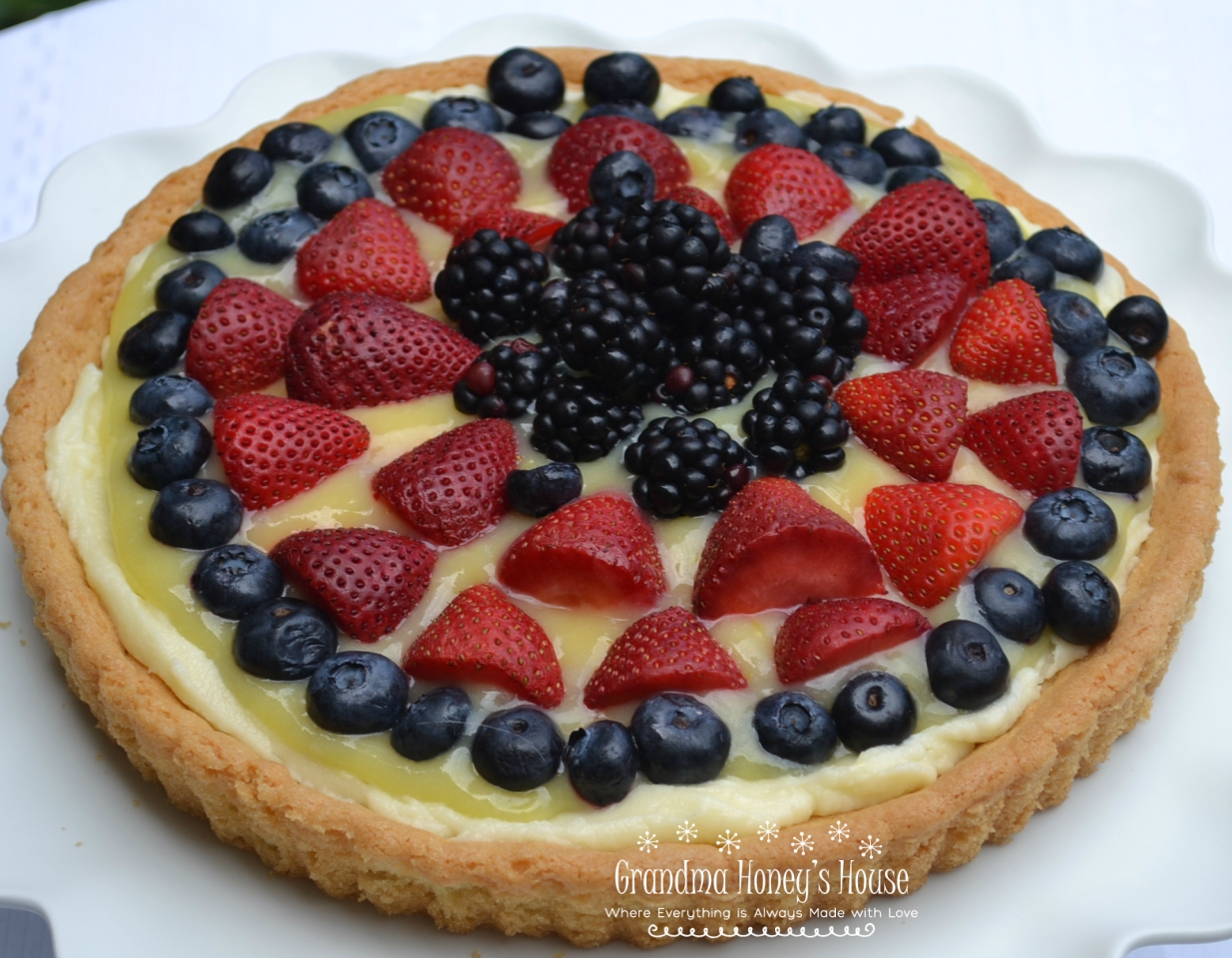 Berry Lemon Mascarpone Cookie Tart is made with a sugar cookie crust that is filled with sweetened mascarpone cheese, lemon curd, and topped with fresh berries.