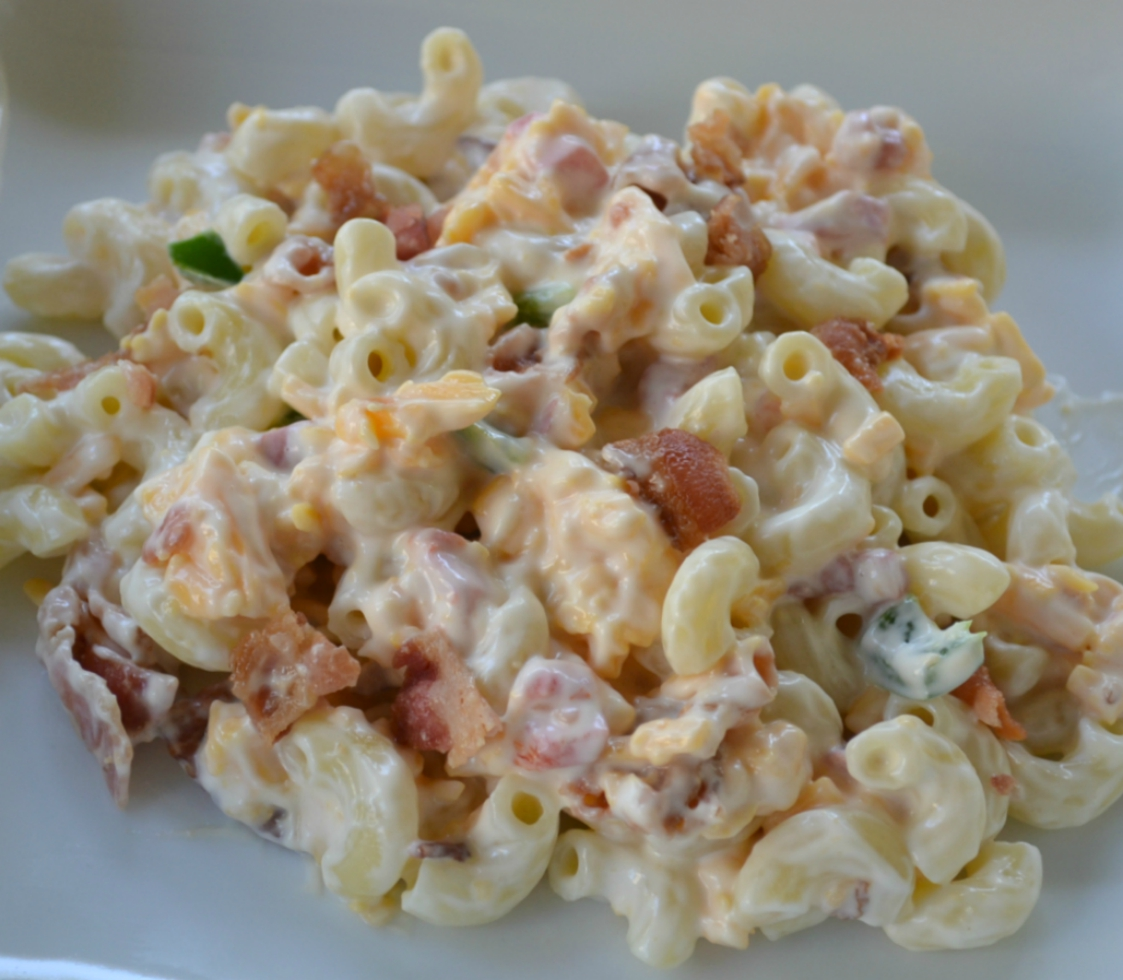 Pimento Bacon Macaroni Salad is the perfect southern style dish with a pimento cheese base, bacon, and a touch of heat from the jalapenos.
