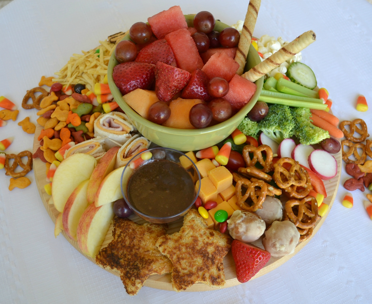 This After School Snack Board is a fun collection of treats for your kids. The board is packed with fruits, veggies, cheese, and sweet treats.