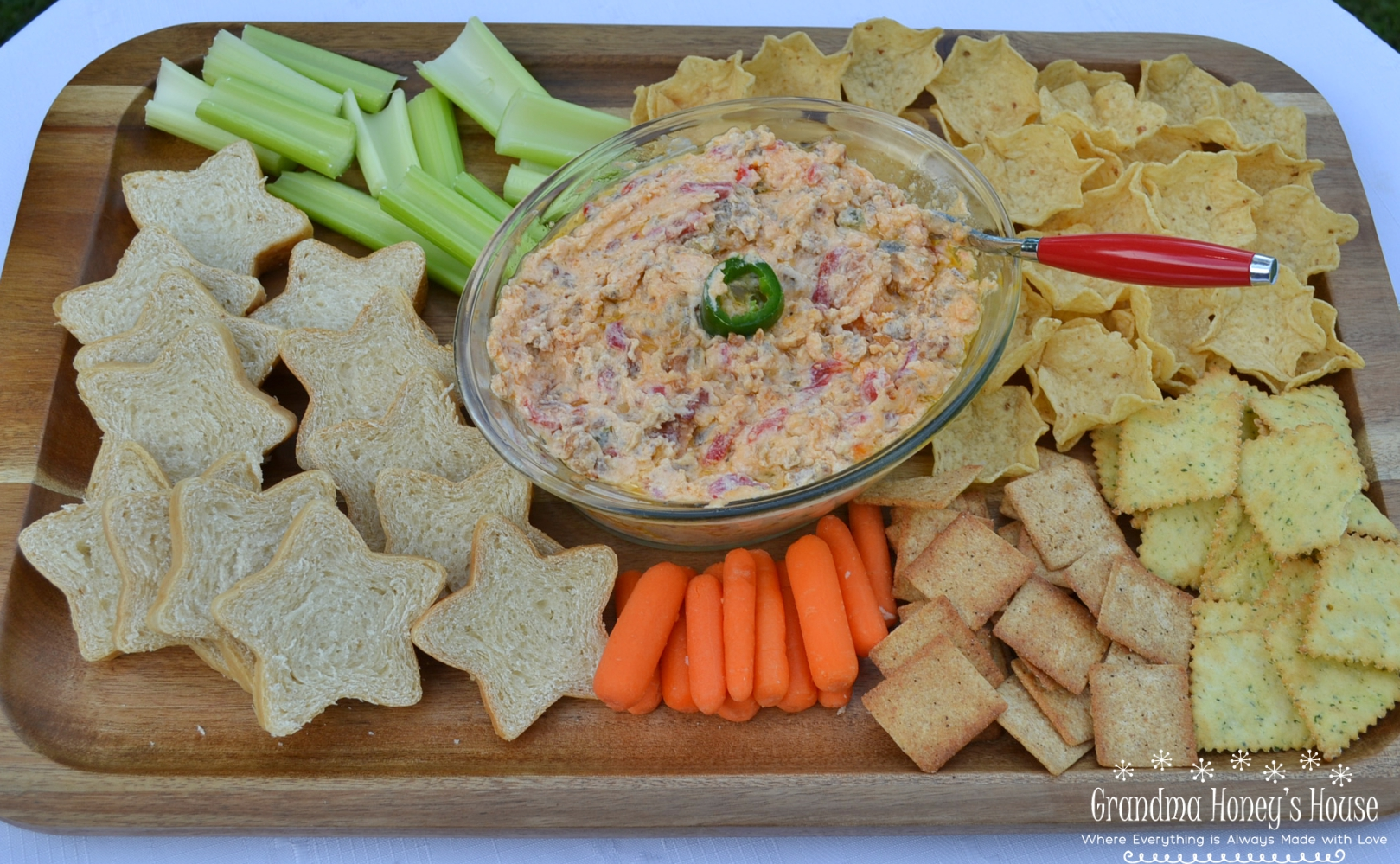 This Hot Pimento-Sausage Dip is perfect for any party. This dip has a pimento cheese base, with bacon, jalapenos, and sausage added. Perfect with chips, crackers,bread, or veggies.