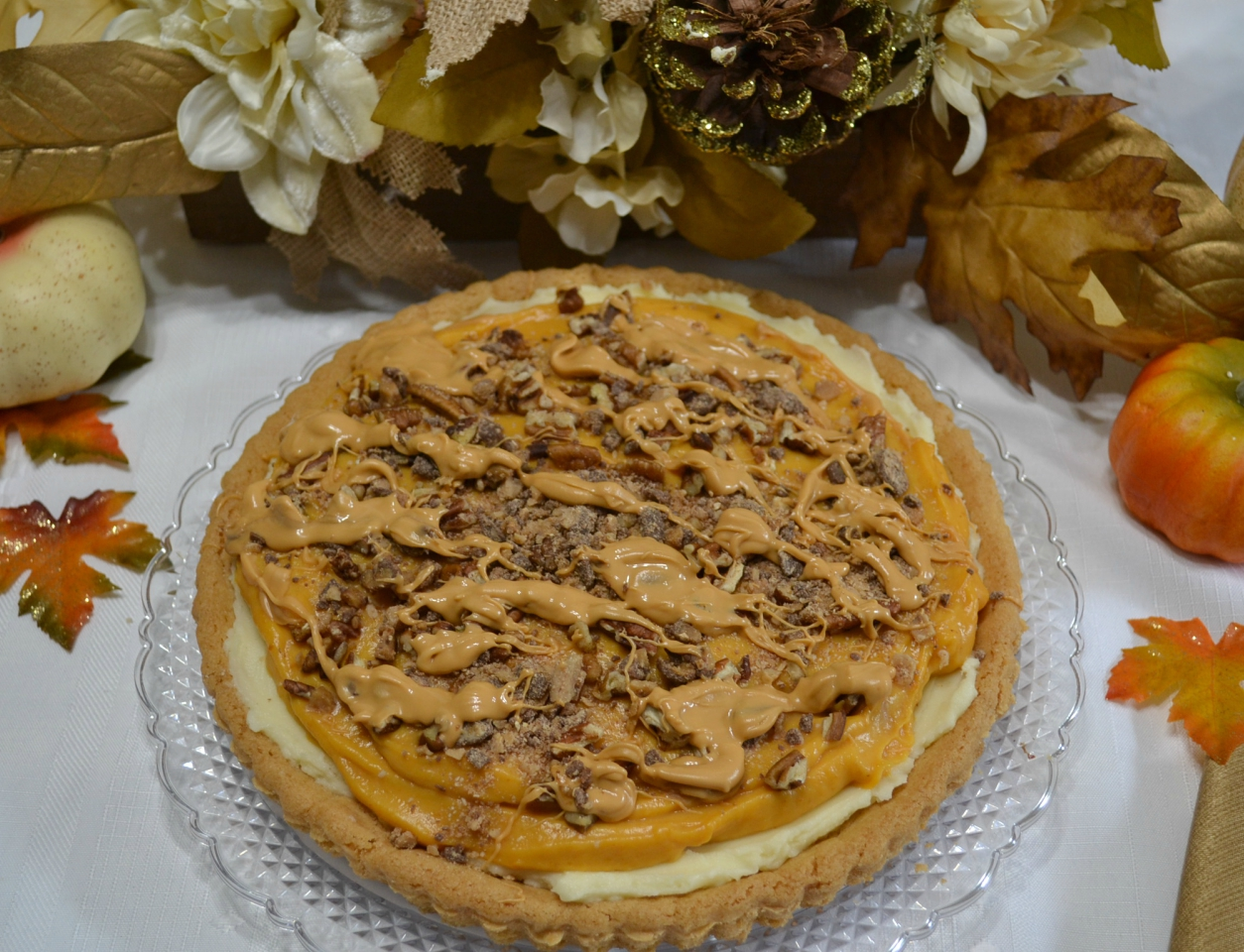 Pumpkin Butterscotch Mascarpone Cookie Tart is a perfect fall dessert with a cookie tart and layers of pumpkin, mascarpone cheese and toppings of toffee bits and butterscotch.