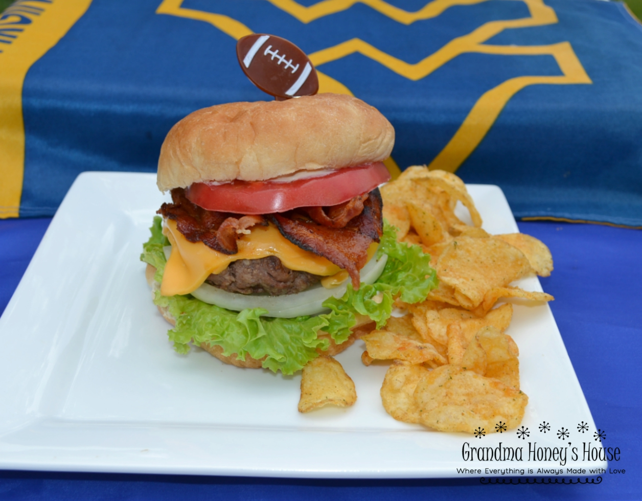 The WV Mountaineer Burger was created to honor the WVU football team and the state of WV. Perfect for tailgates. Loaded with beef, cheese and condiments.