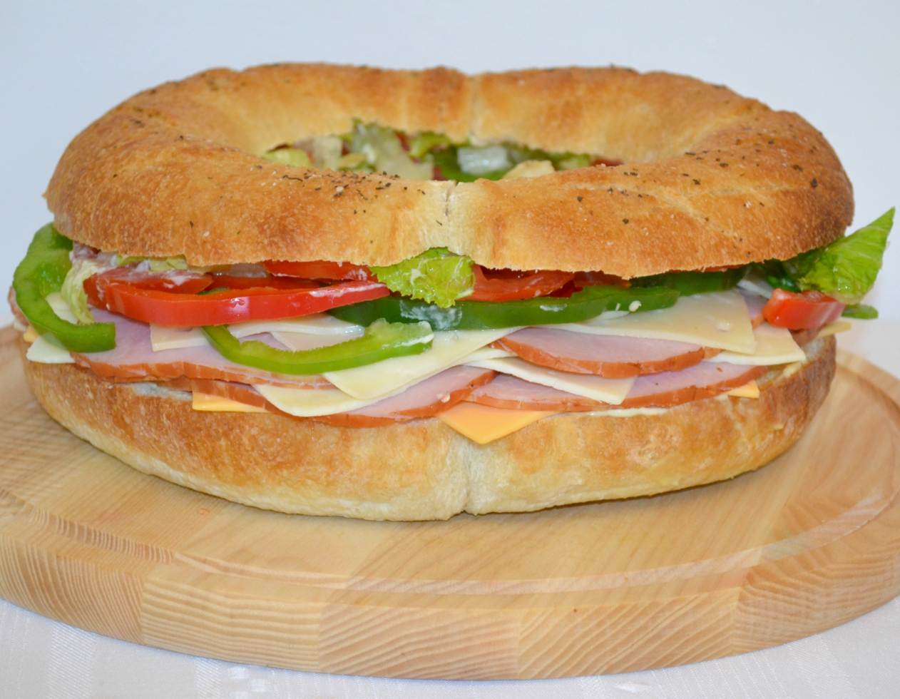 Gourmet Ham and Cheese Party Ring is perfect for any get together. A giant sandwich loaf filled with ham, cheeses, and veggies.