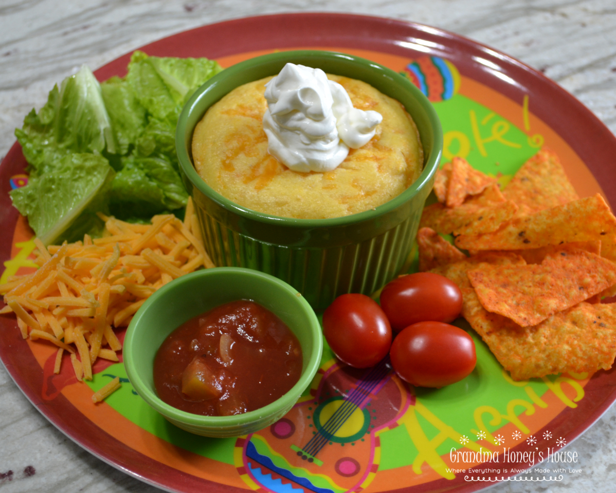 Cornbread Topped Taco Pot Pie is a ramekin filled with a taco meat filling, salsa, cheese, and then covered with a cornbread topping.