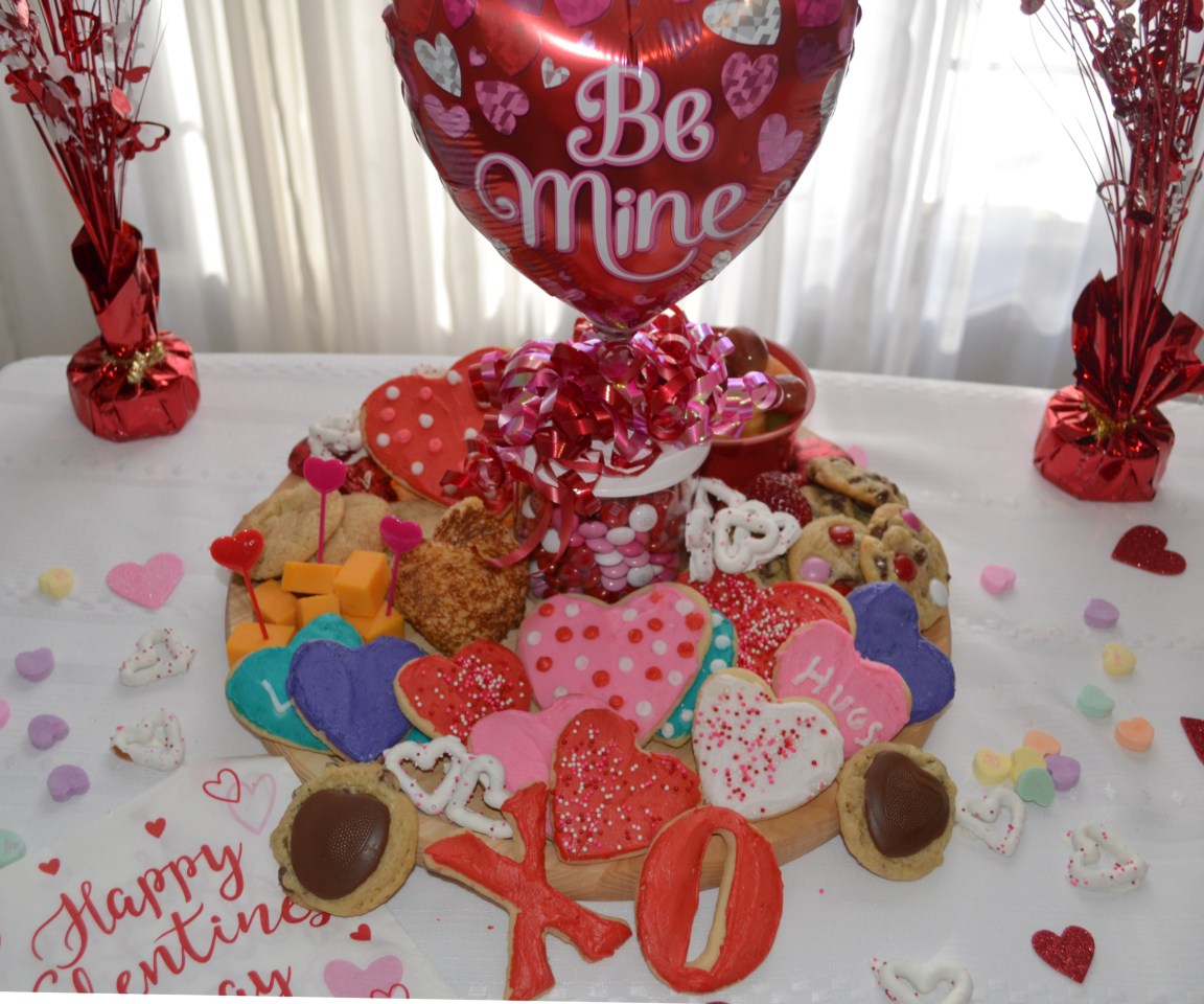 This Valentine's Day Treat Board is filled with sweet and savory treats. Perfect for any party.