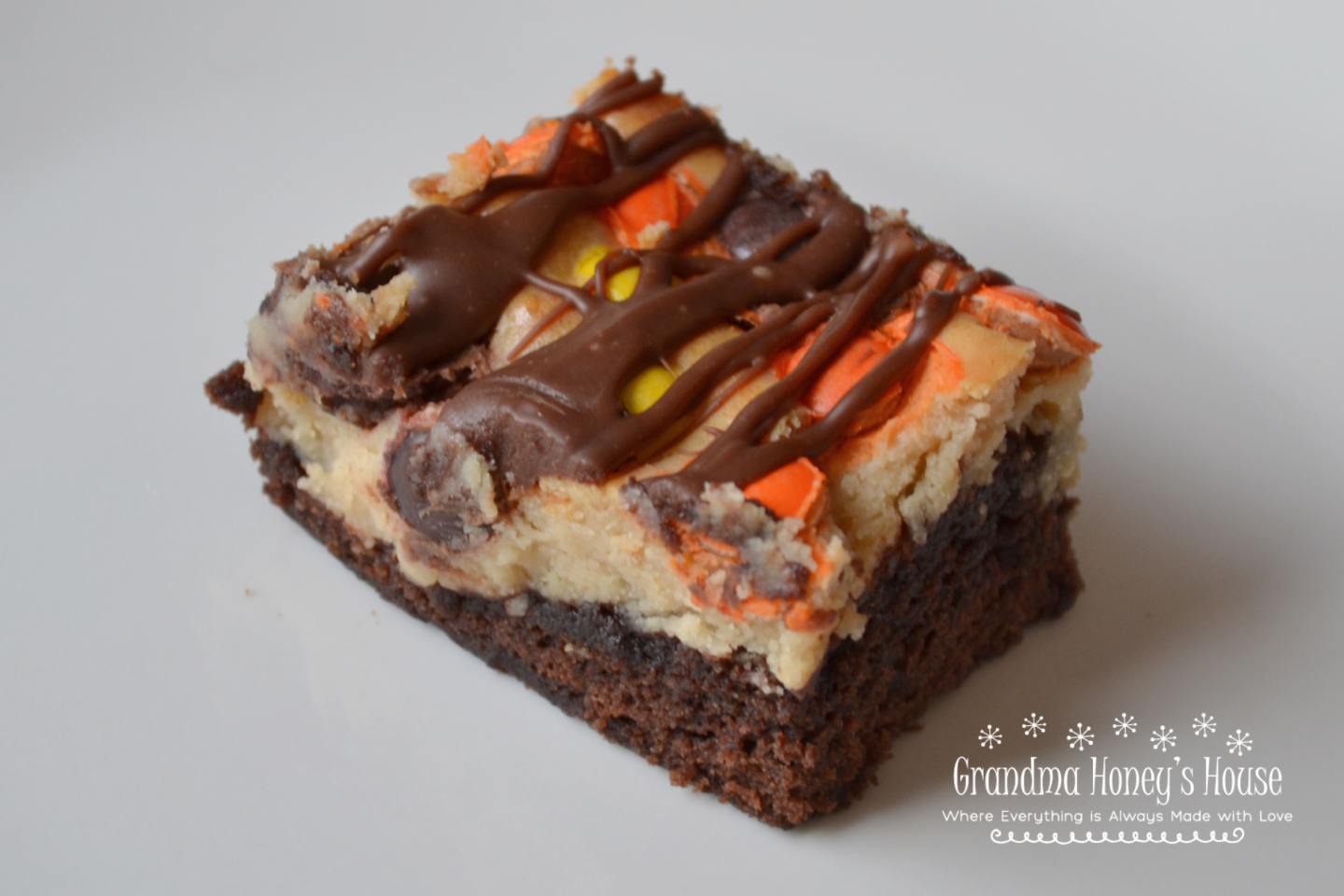 Extreme Peanut Butter Cream Cheese Brownies are extreme because they are a decadent brownie dessert, loaded with a peanut butter cream cheese layer, and then topped with a bag of Reese's Baking Cups and Reese's Pieces Candies