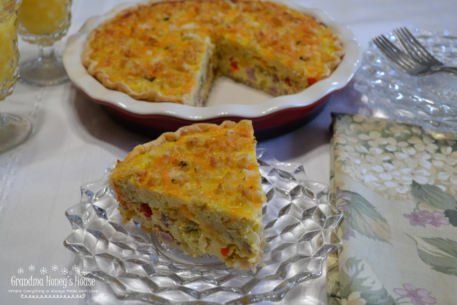 A loaded quiche with sausage, ham, peppers, spinach, cheese, eggs and half and half.  Top it off with a mixture of crumbled tater tots, cheddar cheese, and diced jalapenos for a  special brunch dish