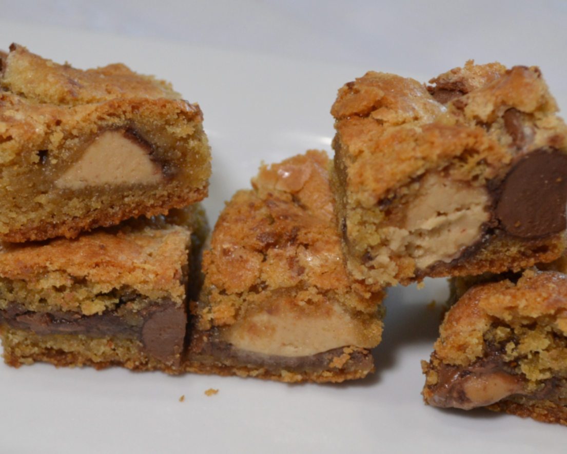 Peanut Butter Candy Bite Cookie Bars are a rich, gooey, treat loaded with peanut butter and bite size pieces of candy.