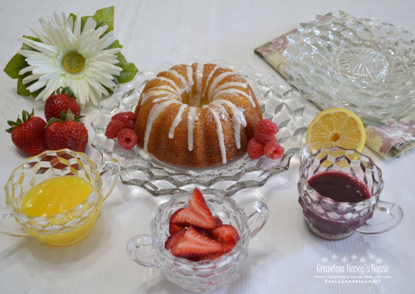 Mini Citrus Bundt Cake with Lemon Curd and Raspberry Sauce is a perfect small dessert with lots of big flavor.