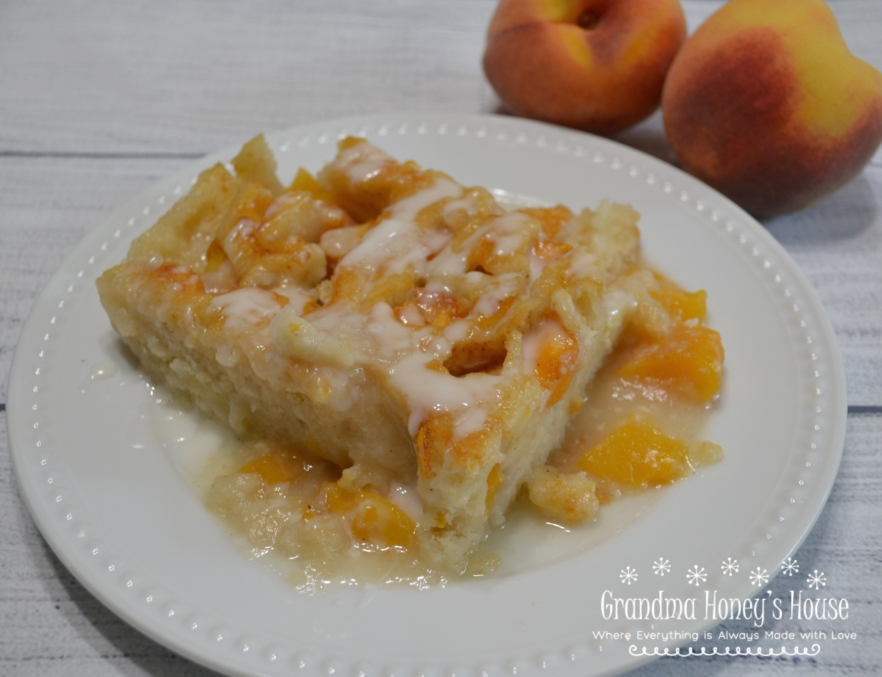A delicious dessert made with fresh peaches and mascarpone cheese, rolled up in a shortbread crust. Baked in a simple syrup then drizzled with a mascarpone glaze.