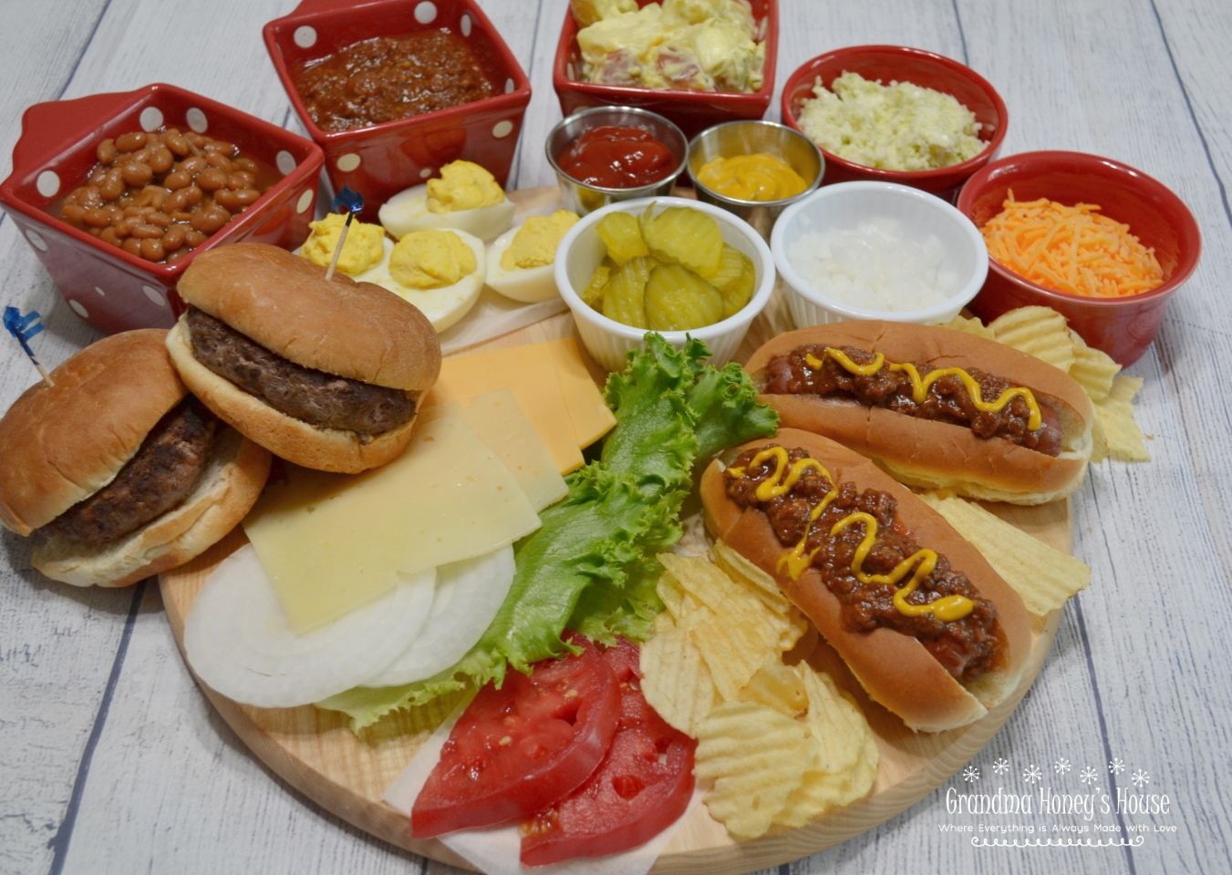 Easy Meals Served on a Board are all the rage. They are colorful and creative. This burger/hot dog board with sides is perfect for 2.