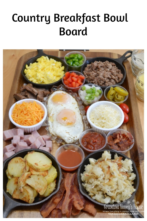 Country Breakfast Bowl Board is loaded with meats,veggies,eggs,toppings,cheeses,and sauces.