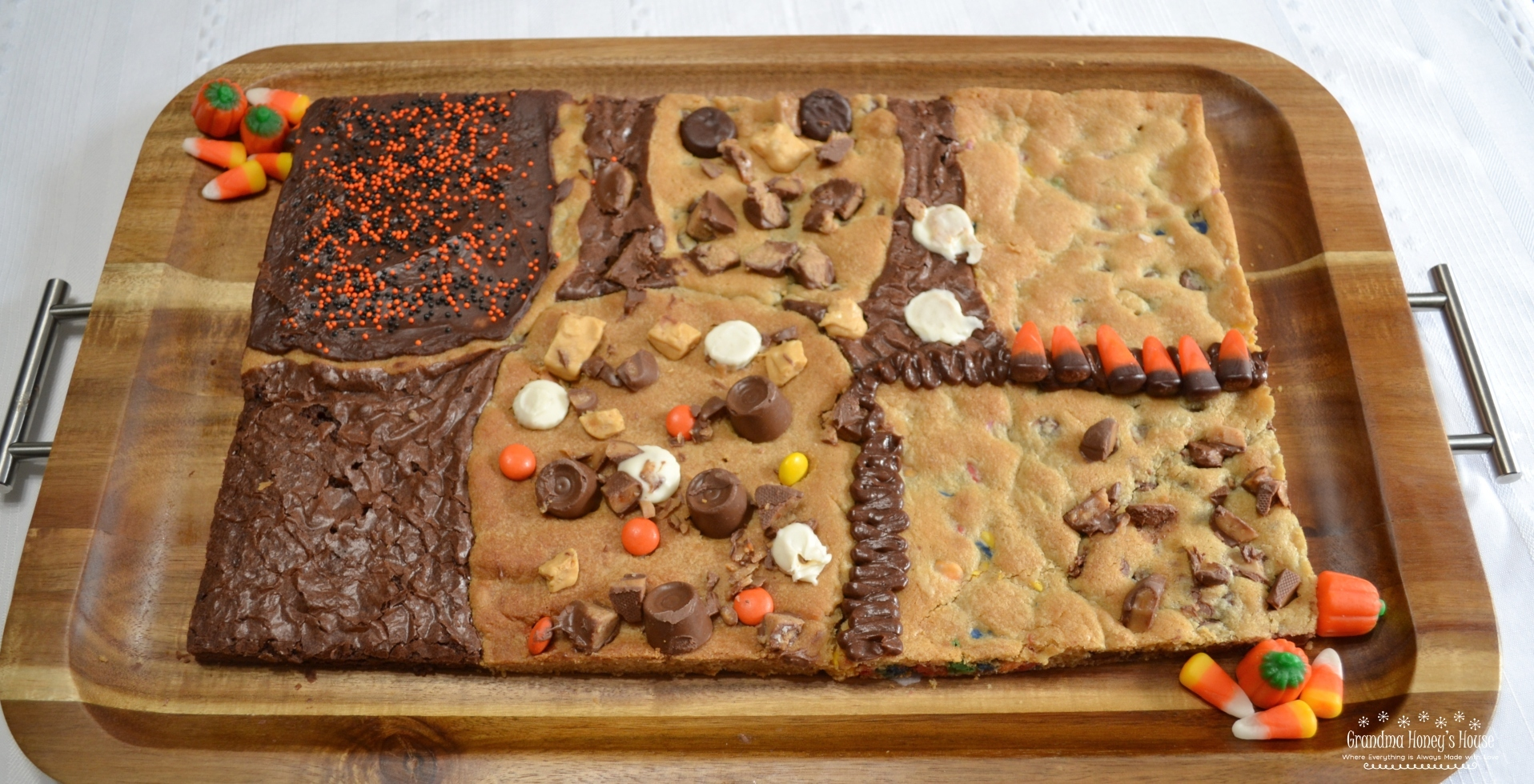 This Halloween Candy Bar Cookie is a mixture of different cookie dough, and brownie mix baked together on a sheet pan. Different candies and chips are added to dough or top the treat.