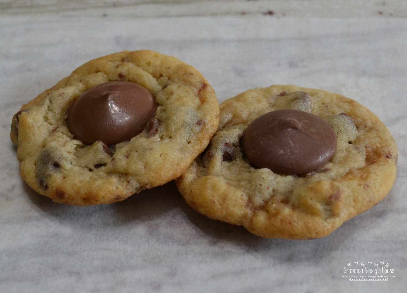 Chocolate Chip Toffee Thumbprint Cookies are a soft cookie loaded with chocolate chips,toffee bits and a Ghirardelli chocolate wafer added to center after baked.
