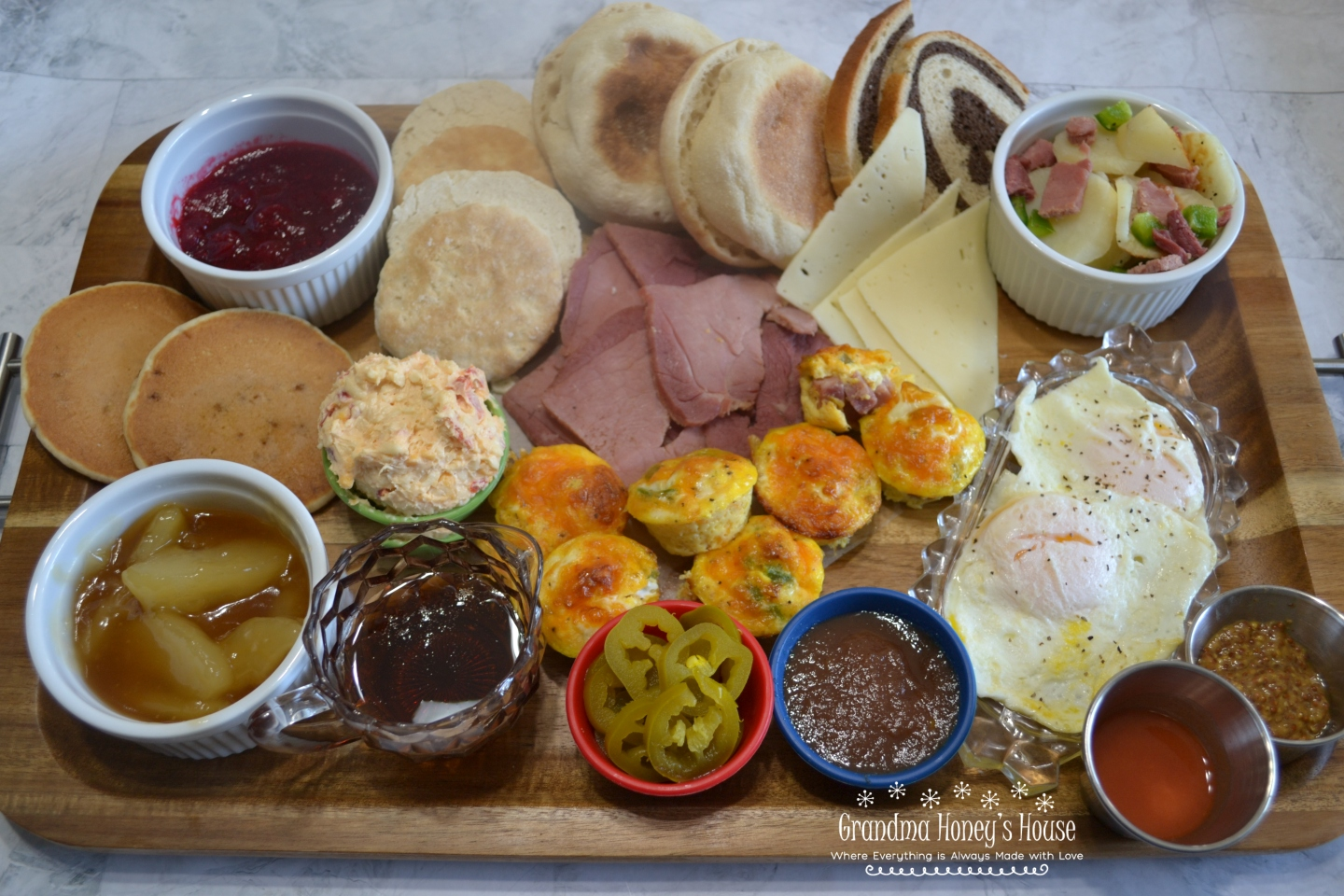 A trendy breakfast board with ingredients chosen to accent the Clifty Farm Country Ham Biscuit Slices