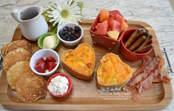Valentine's Day Mini Breakfast Quiche and other foods create this beautiful board to share with your love.