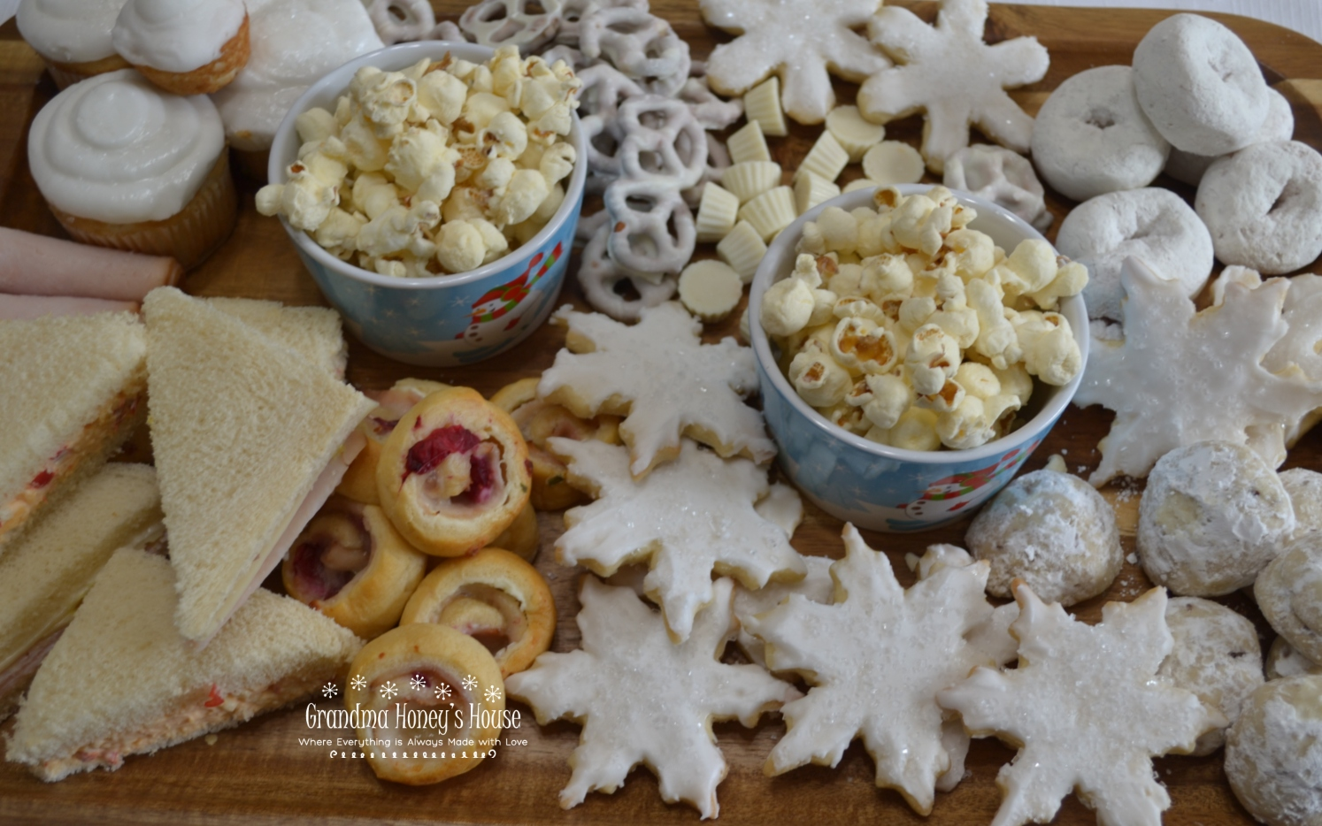 A Winter Wonderland Snack Board filled with savory and sweet, white treats to enjoy on a snowy day