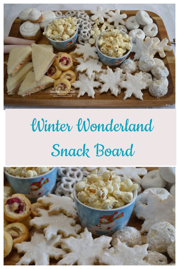 A Winter Wonderland Snack Board filled with savory and sweet, white treats to enjoy on a snowy day.