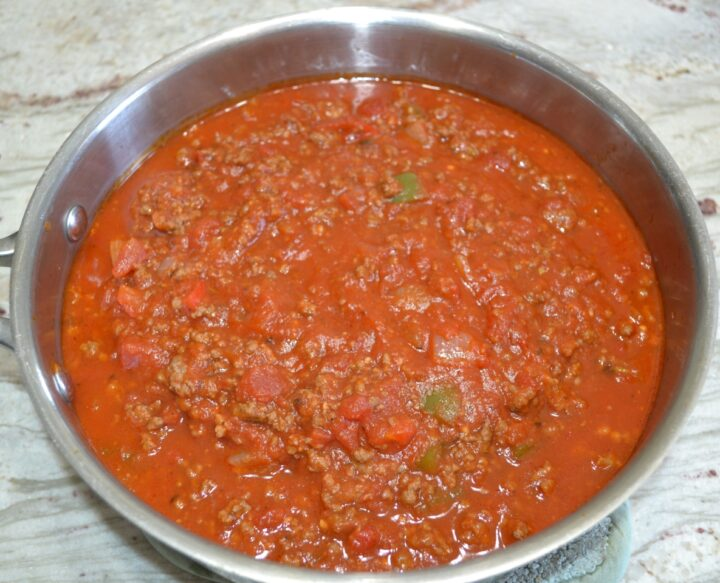 A thick meaty, sauce with sweet italian sausage, ground beef, onions, peppers, garlic, tomatoes, seasonings, and jarred pasta sauces.