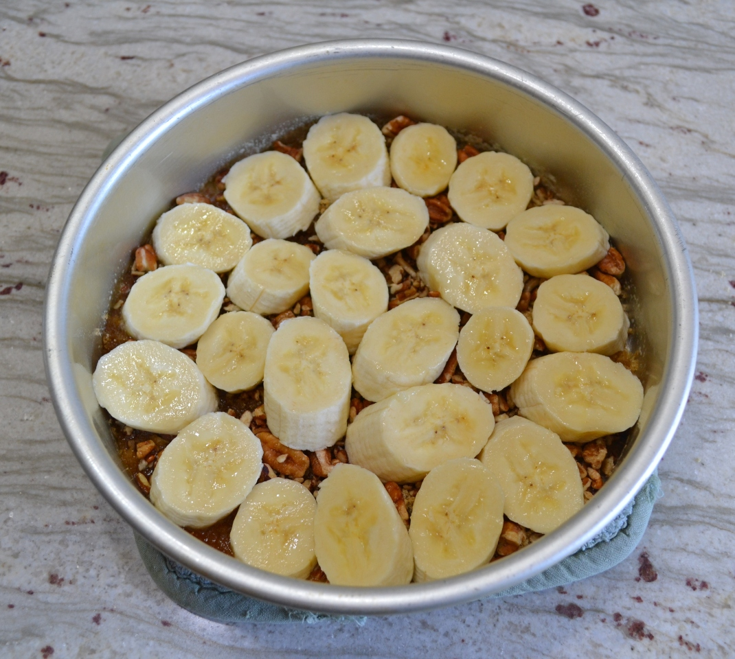 Caramel Banana-Nut Breakfast Rolls A pan of sticky, pull-apart rolls made with refrigerated biscuits, bananas, butter, brown sugar, nuts, and drizzled with caramel topping.